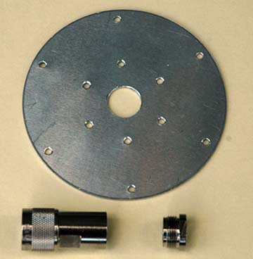 Photo 1 Ground plane radial element mounting plate with related components.