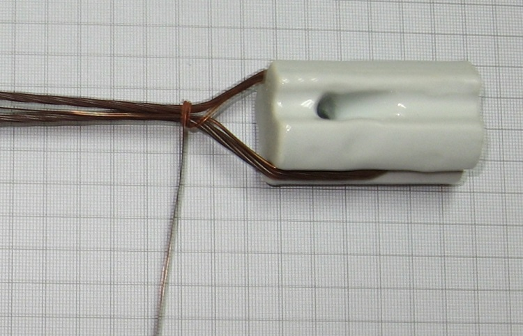 Photo#3. The sorter tail side of the tie wire is laid along the antenna wire and tail with the longer side wound on tightly binding the antenna wire, tail and sort side of the tie wire together.